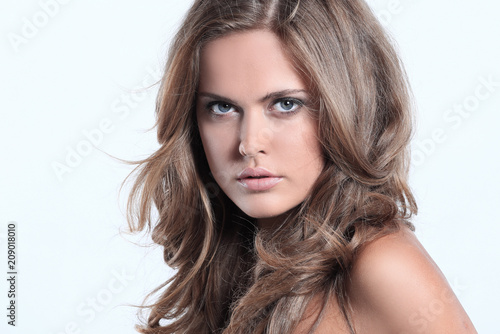 attractive woman portrait on grey background brunette looking at