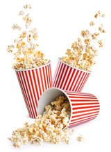Falling Popcorn In Box Isolated On A White Background. Popcorn In Striped Bucket.