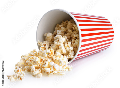 Papiers peints Graine, aromate Popcorn in striped bucket isolated on a white background.
