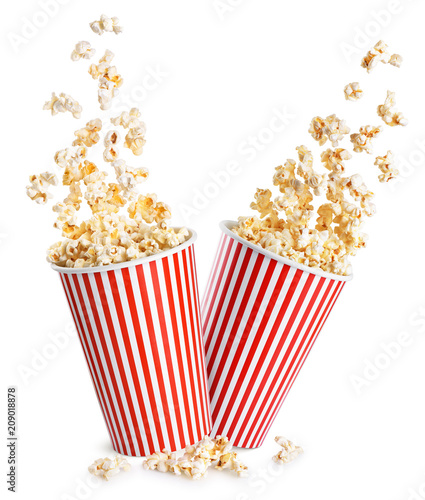 Poster de jardin Graine, aromate Falling popcorn in box isolated on a white background.