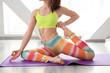 Beautiful woman practicing yoga indoors