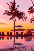 Beautiful Outdoor View With Umbrella And Chair Around Swimming Pool In Luxury Hotel And Resort