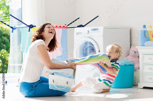 Fotografiet Family in laundry room with washing machine