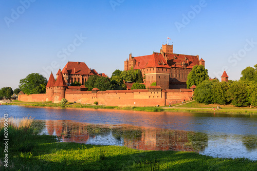 Garden Poster Old building Teutonic Castle of Malbork reflected in water