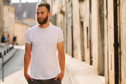 Hipster handsome male model with beard wearing white blank t-shirt with space fo Poster
