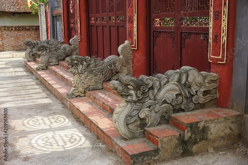 Dragon guardians outside a Buddhist temple in Vietnam Poster