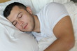 Relaxed ethnic male sleeping like a baby