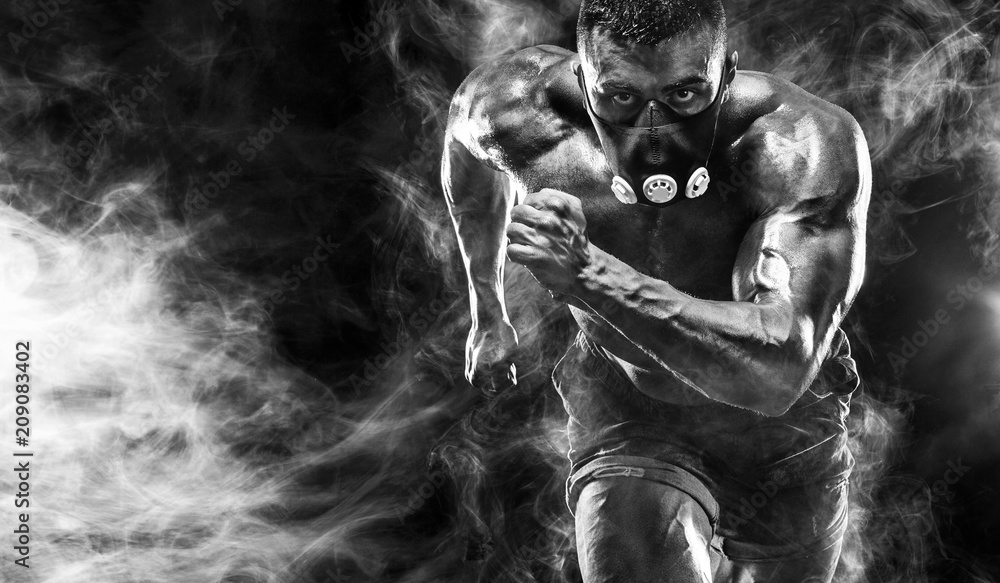 Fototapety, obrazy: Strong athletic man sprinter in training mask, running, fitness and sport motivation. Runner concept with copy space. Dynamic movement.