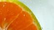 Macro of orange fruit in water