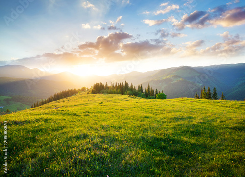 Foto op Plexiglas Blauwe hemel Sunset in the mountain valley. Beautiful natural landscape in the summer time