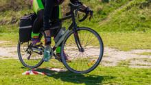 Female Cyclist In Helmet Holdi...