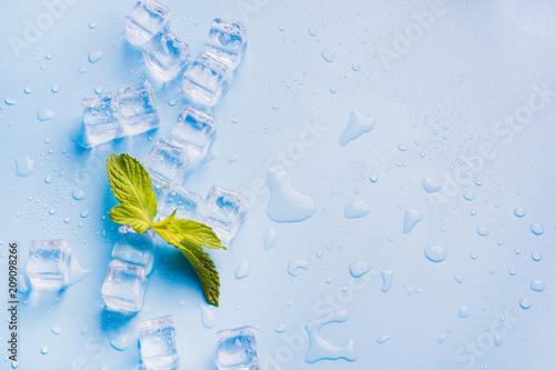 Carta da parati  Ice with mint isolated on blue.