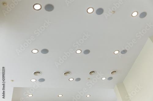 Suspended ceiling and plasterboard with built-in lights in the decoration of the apartment or house