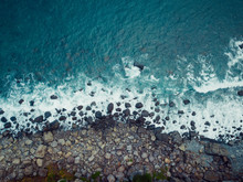 Aerial View Of Volcanic Sea Shore With Waves