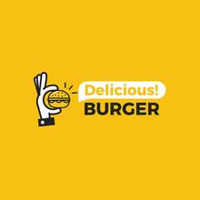 Delicious Burger. Hand With A Small Hamburger.