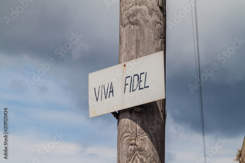 Fotografie, Obraz  Small sign on a street saying Viva Fidel (Long live Fidel) on a street in Matanz