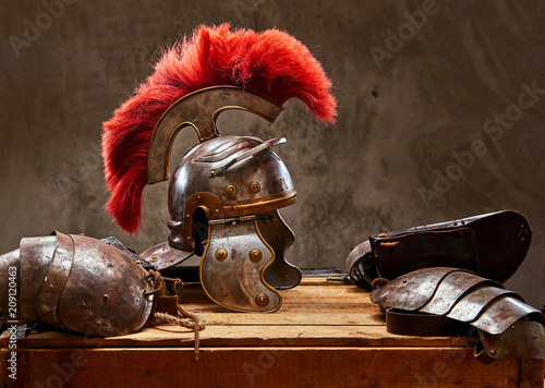 Obraz na płótnie Complete combat equipment of the ancient Greek warrior lie on a box of wooden boards