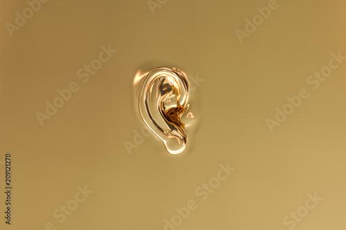 Fotografie, Tablou An ear as a background in gold look - 3D Rendering