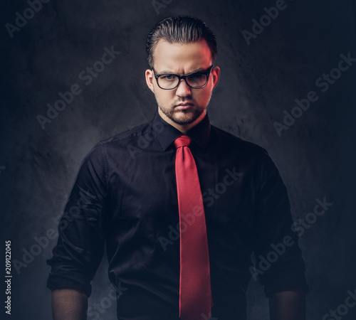 32c3156ee92d Portrait of a brilliant villain in a black shirt with a red tie ...
