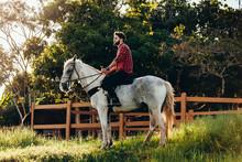 Young Man Riding White Horse O...