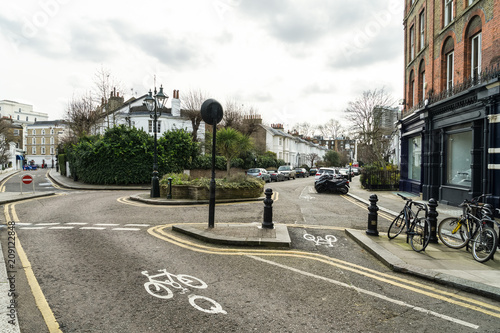 Empty street in Kensington and Chelsea London United Kingdom with houses cars an Poster