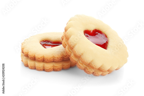 Foto auf Leinwand Kekse Traditional Christmas Linzer cookies with sweet jam on white background