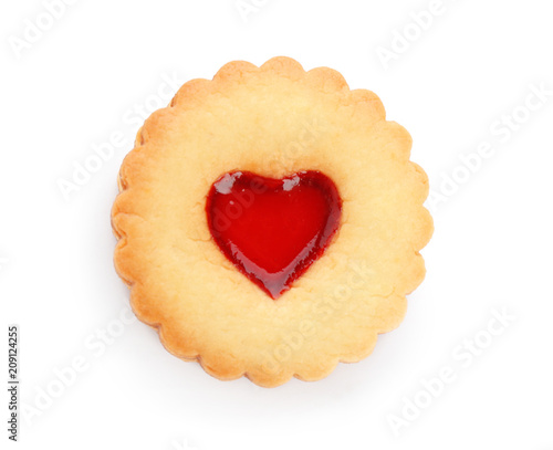 Traditional Christmas Linzer cookie with sweet jam on white background
