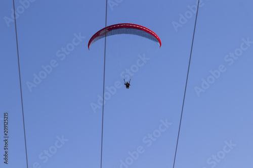 Fotobehang Luchtsport Skydiver on blue sky background