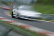 Fast car on racetrack - Stockphoto