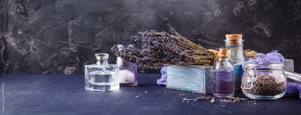 Fototapety, obrazy: Essential lavender oil and dry lavender flowers.