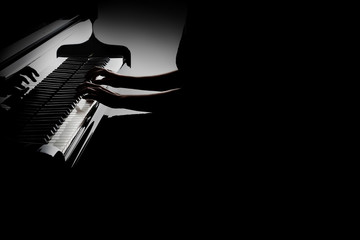 Piano player. Pianist hands playing grand piano