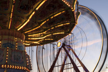 Ferris Wheel And Carousel In Late Afternoon At A Fair Carnival