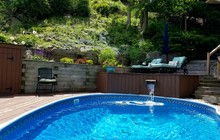 Rustic Poolside Retreat With Waterfall/Water Feature Background; Leisure, Lifestyle, Enjoyment, Relaxation,  Cozy Home, Vacations, Rustic Escape