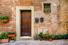Alley With Potted Plants In An Old Tuscan Village