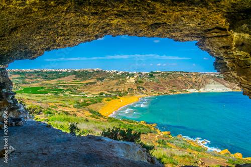 Cuadros en Lienzo Aerial view of Ir-Ramla bay at Gozo through Tal-Mixta Cave, Malta