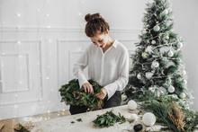 Woman Making Christmas Decorat...