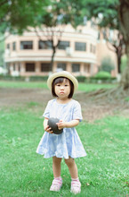 Little Girl With A Rugby Ball