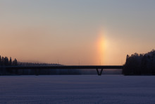 Sundogs At Winter On Frozen Lake