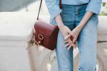 Close Up Shot Of Woman's Jeans And Shoulder Bag