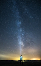 Man Illuminating With A Lantern The Milky Way