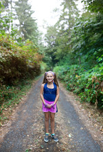 First Day Of Fifth Grade - Ten Year Old Girl In Pig Tails Is Ready To Walk To School.