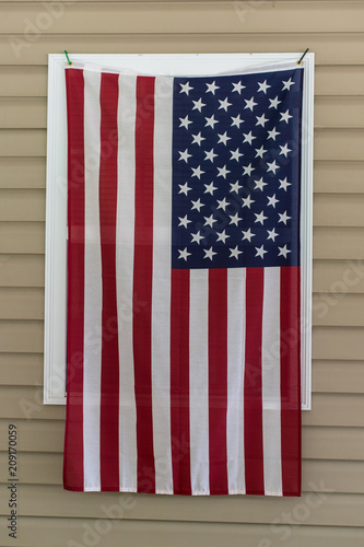 American flag hanging on a window