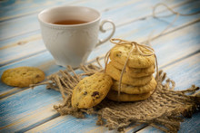 Cup Of Tea With Biscuits On A Blue Wooden Background