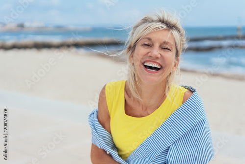 Fotografie, Obraz  Laughing vivacious woman with a sense of humour