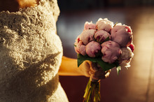 Bride Holding Bridal Bouquet With Fresh Pink Roses