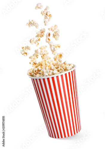 Cadres-photo bureau Graine, aromate Falling popcorn in box isolated on a white background.
