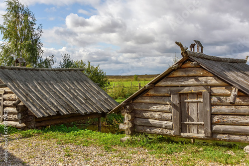 Tuinposter Oude gebouw An old wooden rural building for hrananiya products