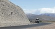 Route curve with van and truck passing by. Truck full of concrete for construction. Mendoza, Cuyo Argentina.