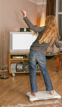 Girl Gaming In Front Of Tv