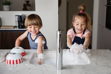 Kids Playing With Suds While Washing Dishes